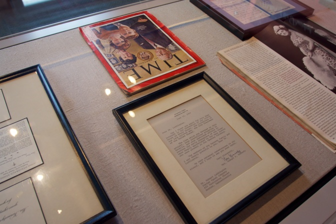 Glass case of magazine articles regarding the Kennedys, as well as their correspondence.