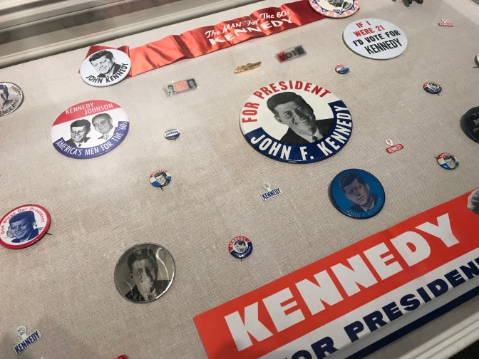 Pins, buttons, and bumper stickers supporting President Kennedy's election.
