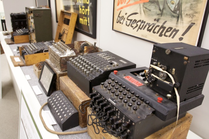 A row of 6 Enigma machines.