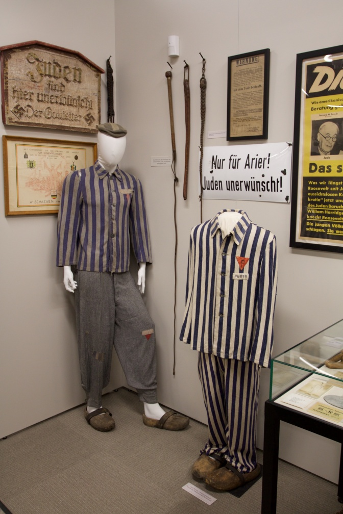 Exhibit on the Holocaust, including prisoners uniforms.