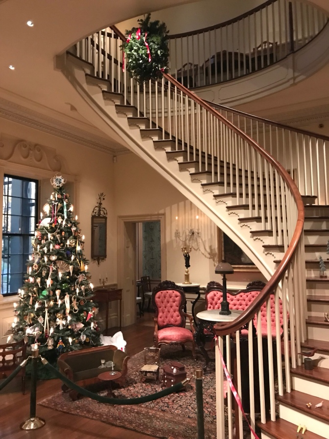 Spiral staircase. A Christmas tree is on the first floor