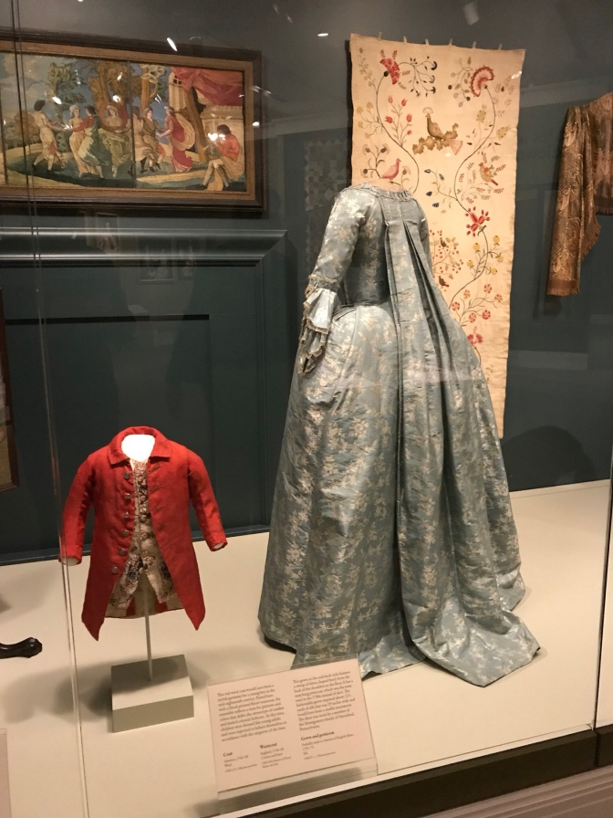A boy's coat and a woman's gown and petticoat, both from the 18th century.