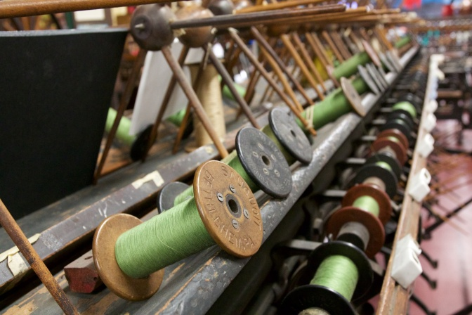 Spools of silk on silk winder.