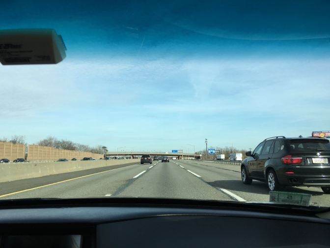 View of the NJ Turnpike through the windshield.