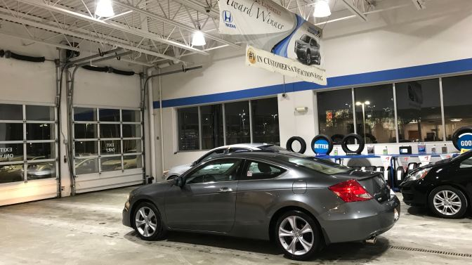 2012 Honda Accord in Honda dealership garage.