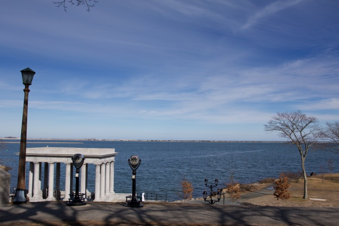 View of Plymouth Harbor, with the portico that houses Plymouth Rock in the foreground.