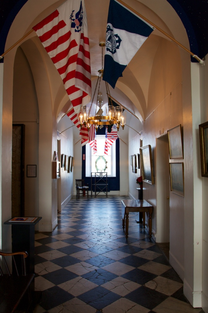 Entrance hall to the museum. Flags hang from the ceiling.