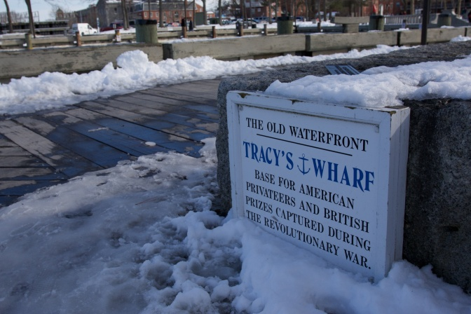 "Sign that reads: ""The Old waterfront. Tracy's Wharf: Base for American Privateers and British Prizes Captured During the Revolutionary War."""