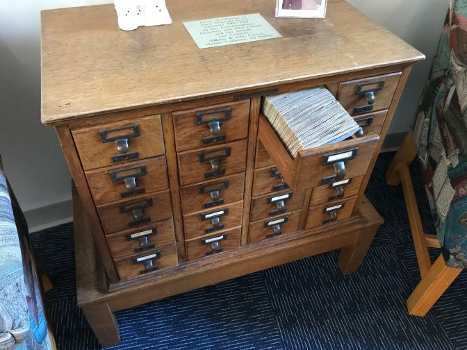 Card catalog with open drawer.