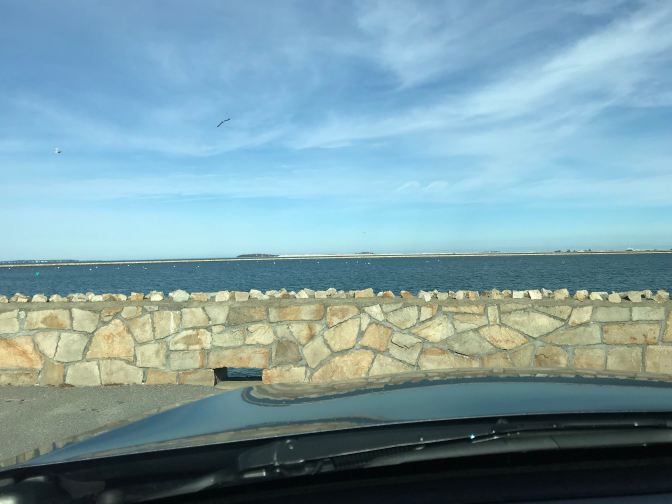View of Plymouth Harbor from behind wheel of car.