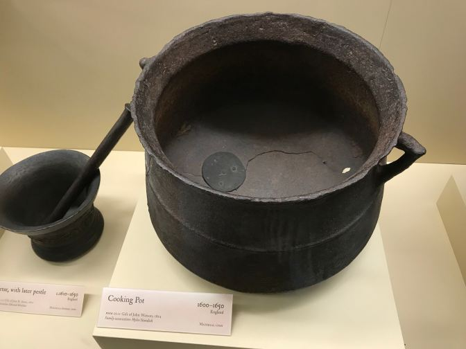 Iron cooking pot.