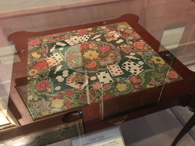 Card table with embroidered top.