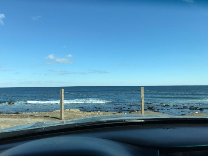 View of Narragansett Bay from behind the wheel of a car.