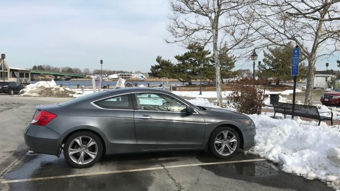 2012 Honda Accord in parking lot, snow near the vehicle.