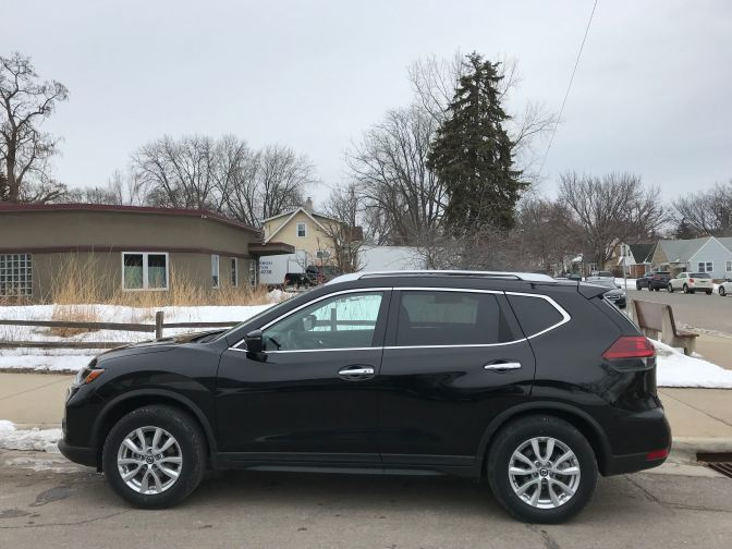 2017 Nissan Rogue, black, parked along side street.