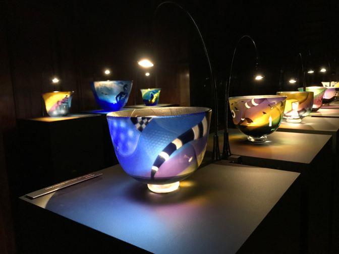Glass bowls on display in art installation.