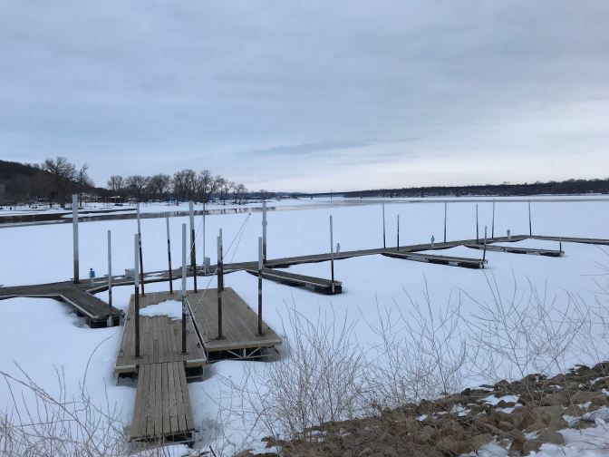 Frozen St. Croix River, with docks in the foreground.