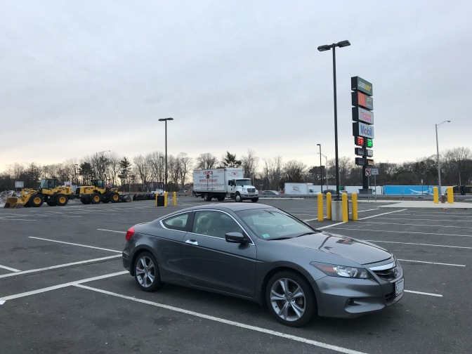 2012 Honda Accord parked in empty parking lot.