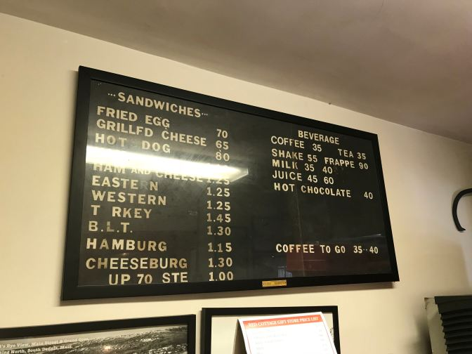 Menu board from 1981, listing items and prices.