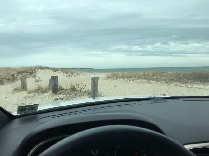 View of the Atlantic Ocean through the windshield of a car.