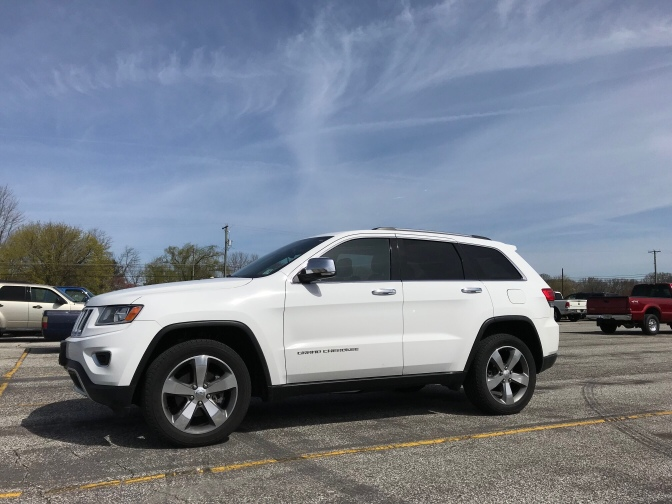 2014 Jeep Grand Cherokee Limited, in white.