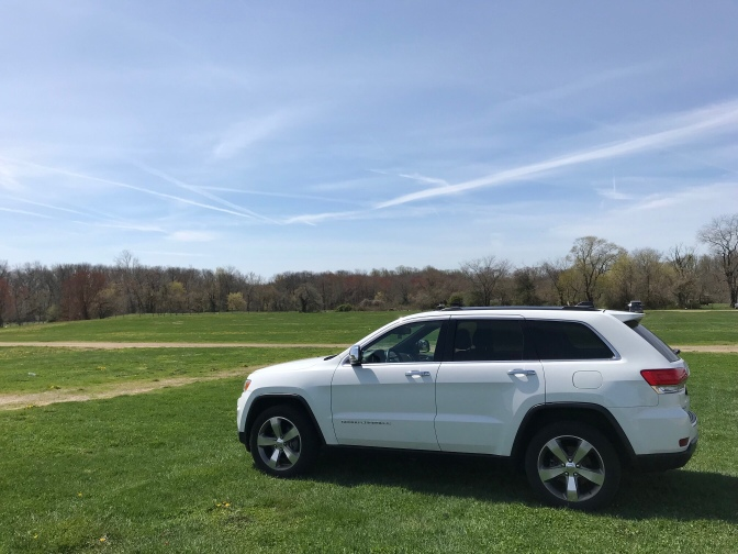 2014 Jeep Grand Cherokee, parked in a field.