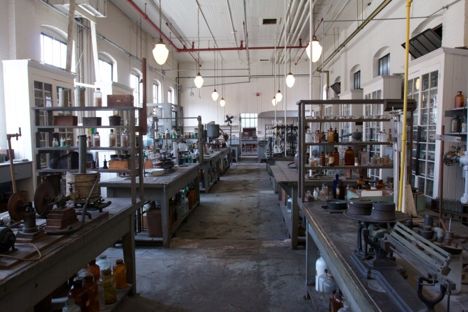 Interior of the Chemistry Lab. Machines and bottles fill the tables in the lab.