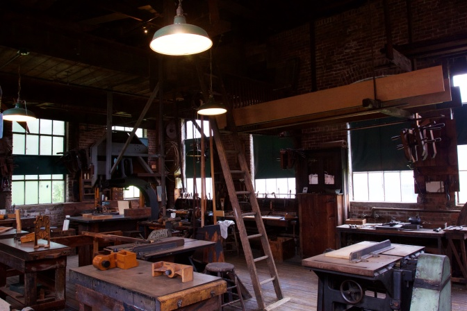 Interior of the pattern shop. Tools are on the tables, and a ladder is in the middle of the room.