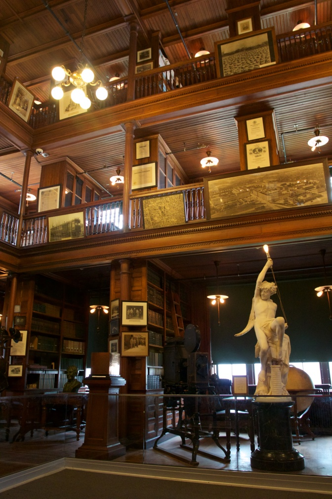 Edison Laboratory library, with a large statue on the ground floor of a three-level room.