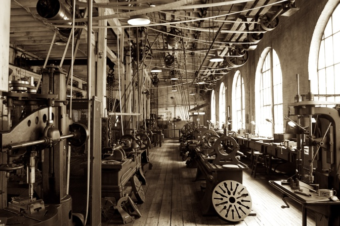 Heavy machine shop, with machines in rows across the room.
