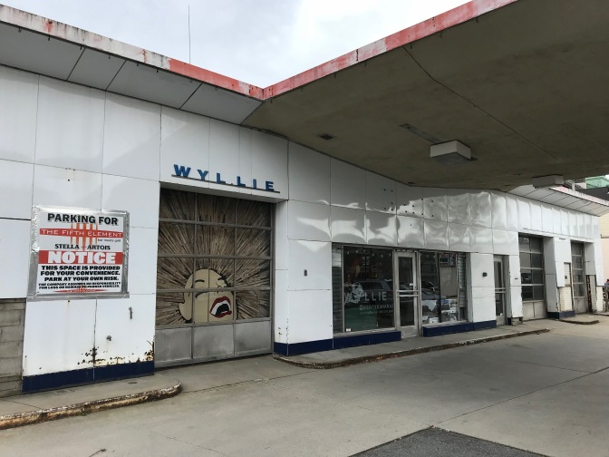 Gas station with art installation on garage door.