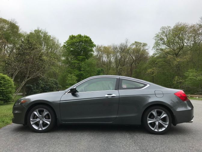 2012 Honda Accord coupe, parked in a parking lot.