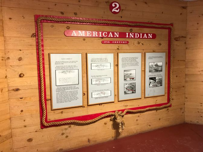 Wall placard display on theory of American Indian origin.