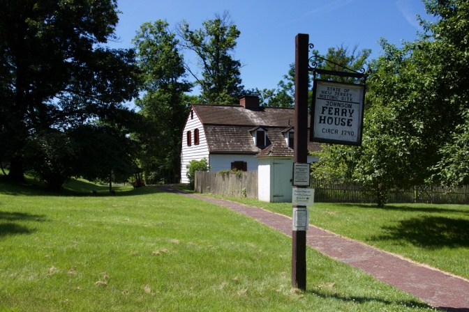 Johnson Ferry House. A sign in the foreground says STATE OF NEW JERSEY HISTORIC SITE - JOHNSOn FERRY HOUSE CIRCA 1740.