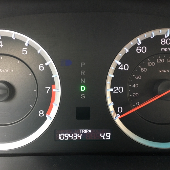 Car odometer reading 109434 miles.
