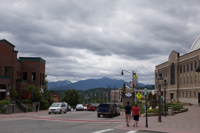 View of downtown Lake Placid, with mountains in the distance.