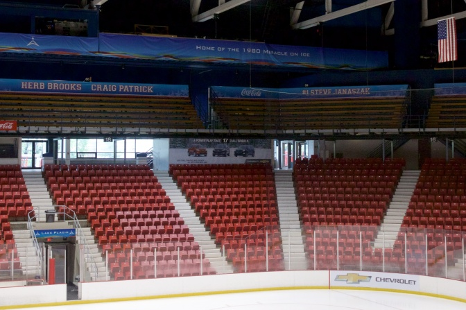 View of the right corner of the arena. A ring of honor - blue banners with white letters, list the names of the team. Visible on the signs in this photo are Herb Brooks, Craig Patrick, Steve Janaszak, and