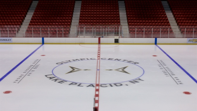 Center Ice circle of the rink. It says OLYMPIC CENTER LAKE PLACID NY.