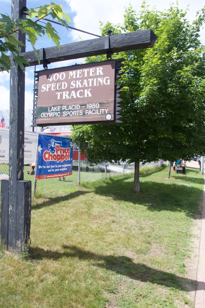 Sign on a wooden signpost that states 400 METER SPEED SKATING TRACK Lake Placid 1980 Olympic Sports Facility