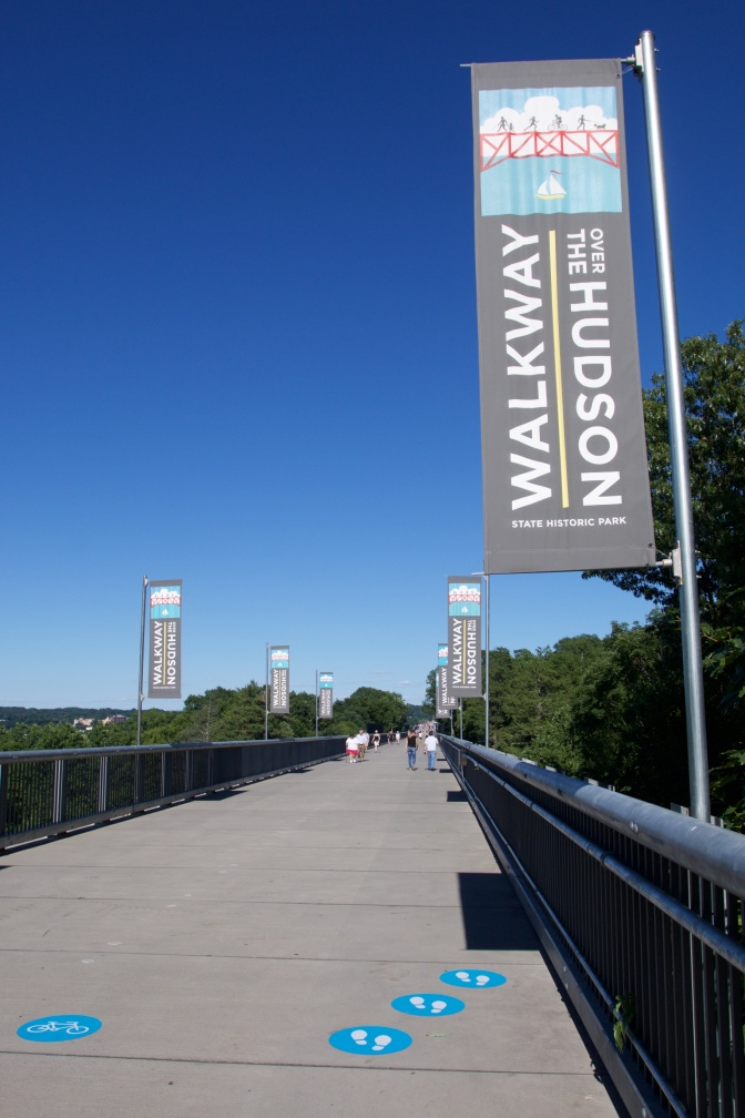 View of Walkway Over the Hudson, with flags along the bridge that say WALKWAY OVER THE HUDSON.