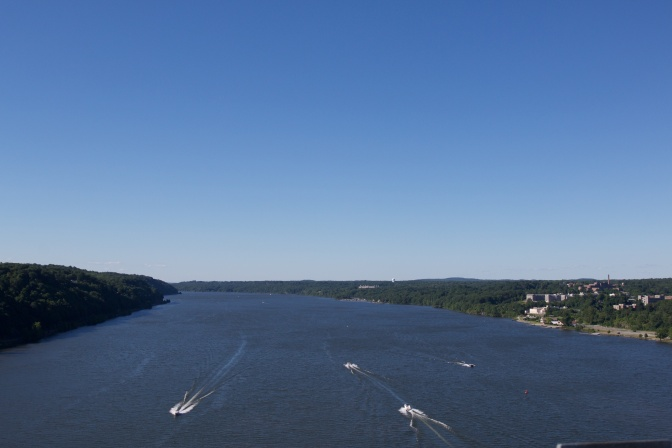 Northward view of the Hudson River, with several small craft on the water.