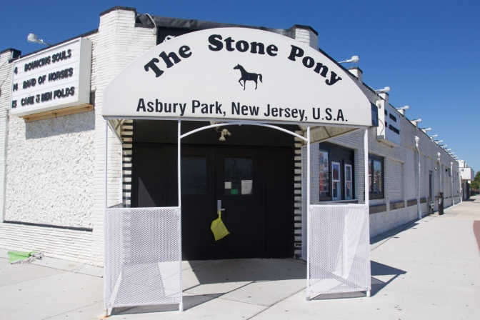 Exterior of The Stone Pony music hall. The awning over the front door reads THE STONE PONY ASBURY PARK NEW JERSEY USA.