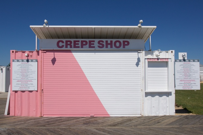 View of a Crepe shop, painted half pink and half white.