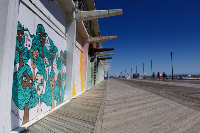 View of murals and boardwalk.