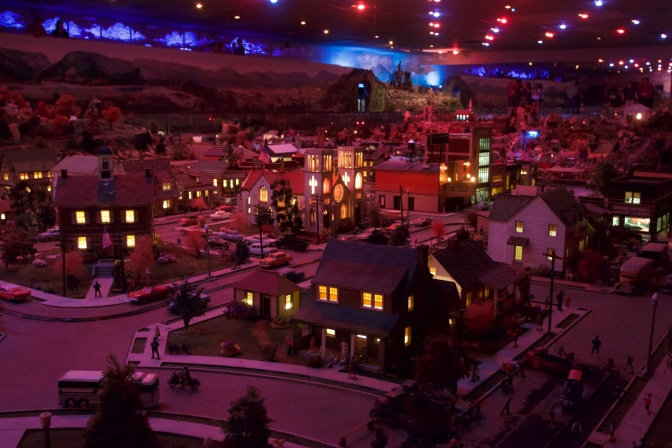 Diorama in low-light with buildings lit during the Night Pageant.