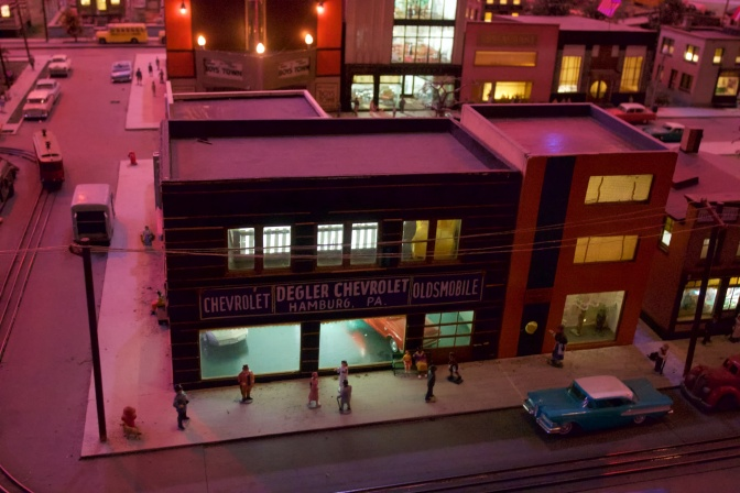 Miniature car dealership. Building sign says DEGLER CHEVROLET HAMBURG PA.