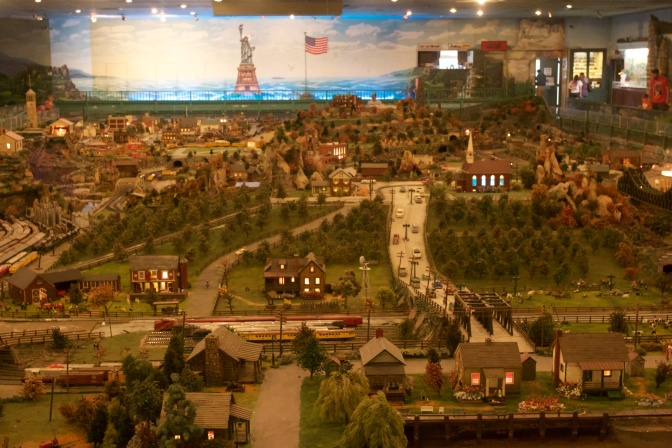Overview of diorama. A large statue of liberty and American flag are on the far wall.