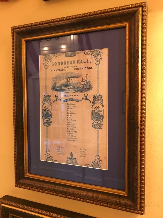 19th century breakfast menu, framed and displayed in a hotel corridor.