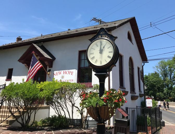New Hope Visitors Center, with a large clock in front of the building.