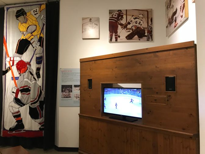 Display on the Miracle on Ice, with a television showing the game.